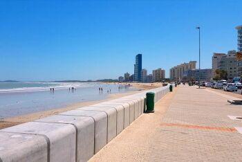 Strand, recurved precast concrete sea wall, Cape Town\'s Helderberg Region, Western Cape
